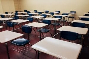 Image of empty chairs in a classroom