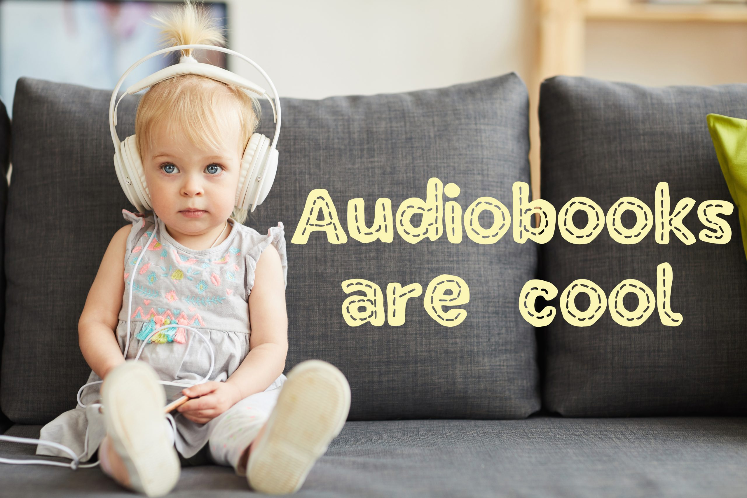 Serious little girl with blue eyes wearing gray dress sitting on sofa in living room and using smartphone to listen to audiobook in headphones. with text that says audiobooks are cool